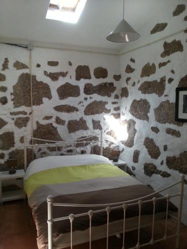 Uma cama ou camas num quarto em Quinta da Barroquinha