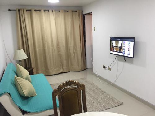 A television and/or entertainment center at Departamento Cavancha Club II