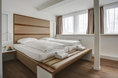 Кровать или кровати в номере Boutique 030 Hannover City