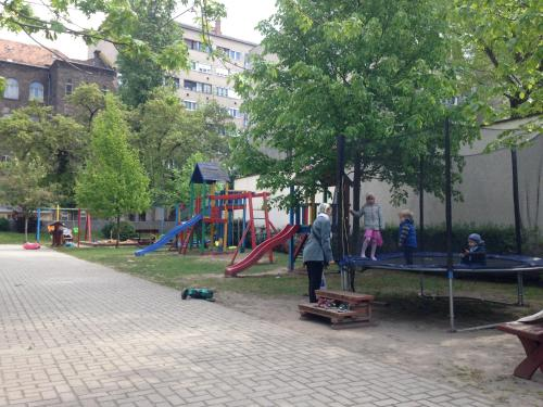Children's play area at Green Frog apartment