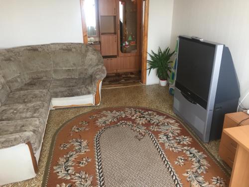 A television and/or entertainment center at Apartment na Lenina 90