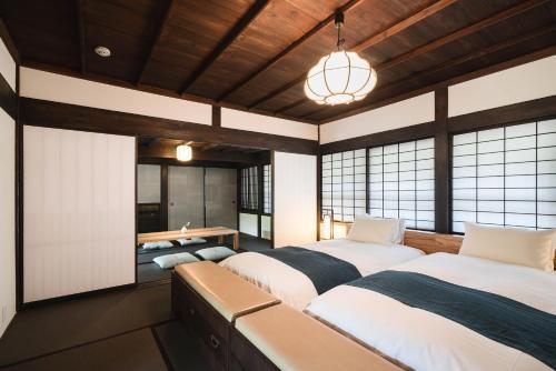 Kiraku 飫肥にあるベッド