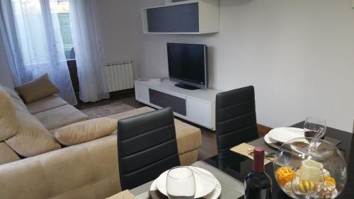 A television and/or entertainment center at Apartamento con encanto
