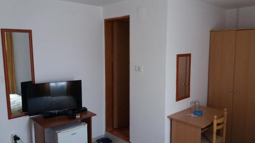 A television and/or entertainment center at Apartments Marko