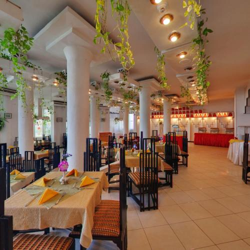 A restaurant or other place to eat at Sand Beach Resort