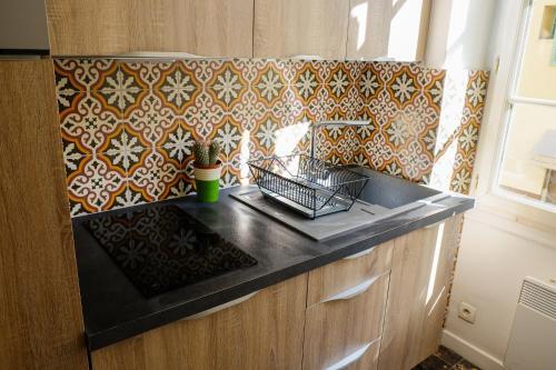 A kitchen or kitchenette at Acropolis loft Nice Garibaldi