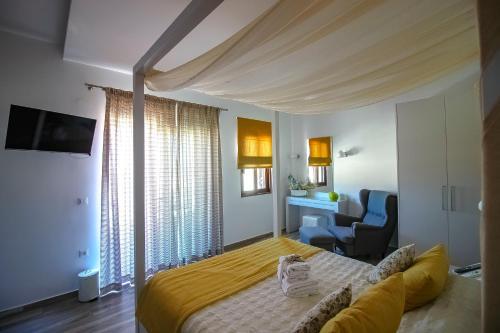 Ένα ή περισσότερα κρεβάτια σε δωμάτιο στο Lindos Beauty