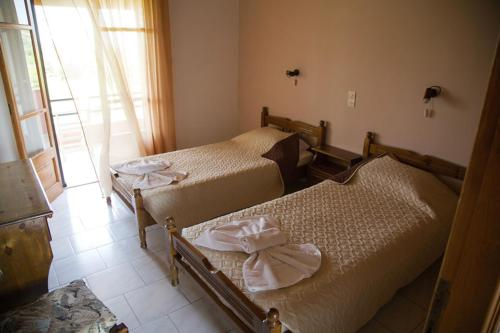 A bed or beds in a room at George Apartments