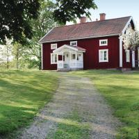 Four-Bedroom Holiday home with Lake View in Landsbro