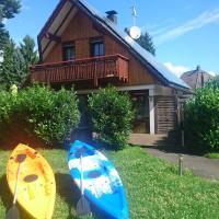 Ferienhaus mit Pool & Kajaks an Badesee