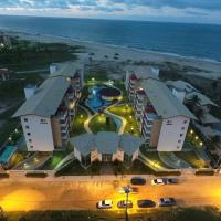 Belíssimo apartamento na beira da praia