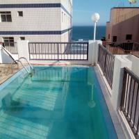 Casa com piscina frente para o mar condominio seguro praia grande