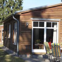 Einfach-schoen-Blockhaus-Schwan-Kaminstimmung-Natur-pur-Ruhe-geniessen