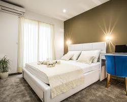 Holiday Apartments & Rooms