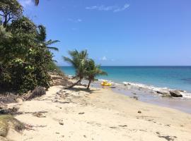 Relaxing sunny beach side resort condo near San Juan