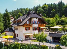 Ferienhaus Holzer, Egg am Faaker See (Bogenfeld yakınında)