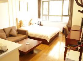 Harbin Warm Holiday Apartment Wanda City Branch, Harbin (Wanbao yakınında)
