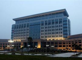 南阳三元大酒店, Baiqiu (Xinye yakınında)