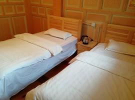 Daocheng Mandi Xiaoyuan Guesthouse