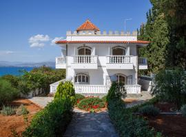 Panoramic view Luxury Villa by the Sea in Paralia Avlidas (Evia), Dhílesi