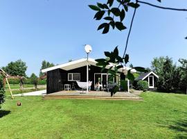 Three-Bedroom Holiday home in Fårvang 9, Sønderby