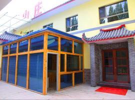 Dunhuang Taoyuan Guesthouse, Dunhuang (Wudun yakınında)