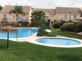 Bonita casa con jardín privado, barbacoa y wifi, Islantilla (La Redondela yakınında)