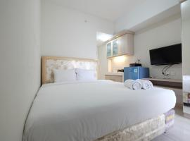 Minimalist Studio Room at The Springlake Apartment Sumarecon Bekasi By Travelio