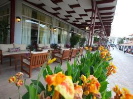 Oassis Hotel, Кассиопи