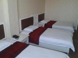 Yining Huarui Business Hotel, Yining (Jelilyüzi yakınında)