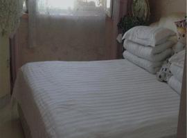 Qilian Snow Mountain Family Apartment, Qilian (Huangzangsi yakınında)