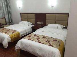 Luo Xia Gou Tian Mei Hotel, Dongchuan (Madian yakınında)