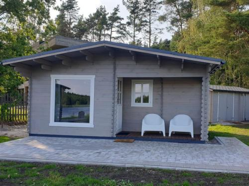 Wooden cottage by the river in Jurmala