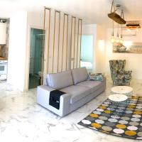 New central 2BR apartment 100m from beach with private parking