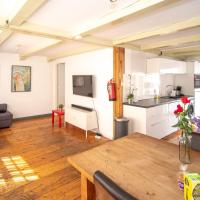 Spacious Central City Apartment with big private Sundeck!