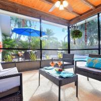 Villa Paradiso near PGA Blvd with a large pool and screened porch