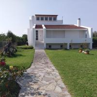 Holiday home next to orange tree orchard