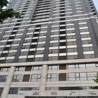 Dalian Xinshijia Ganghui Service Apartment