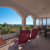 Teuta Apartments - a beach and a sea view