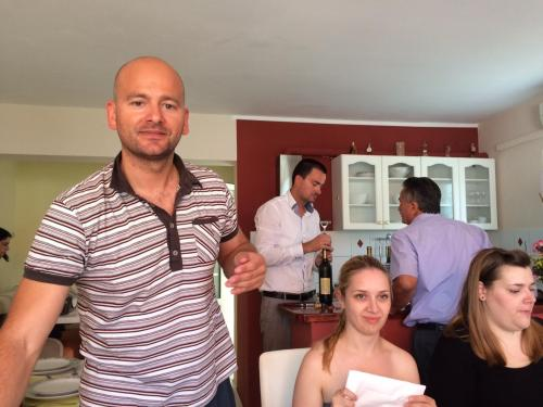 Ante, Slobodan and Alberto (family of owners) with guests