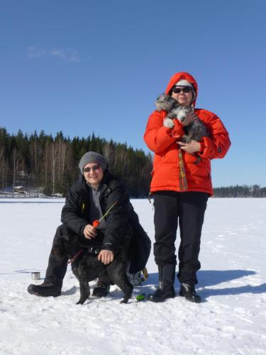 Sirpa, my son and two dogs ice-fishing